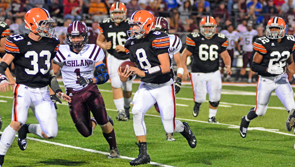 Ironton Fighting Tigers' quarterback Tristan Cox (8) scores on a 39-yard run in the first quarter of last week's 41-13 rout of Ashland. Ironton visits Portsmouth on Friday. (Kent Sanborn of Southern Ohio Sports Photos)