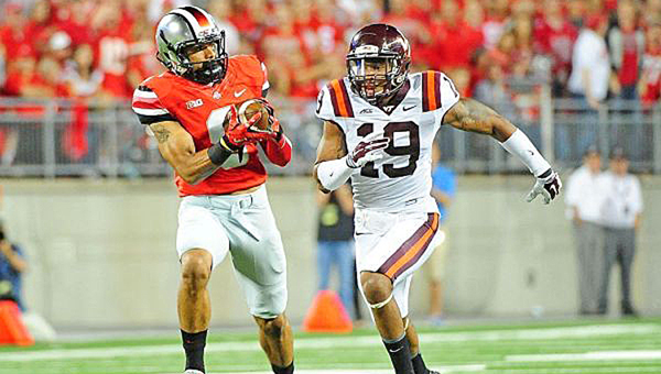 Ohio State Buckeyes' wide receiver Devin Smith (9) makes a catch and run against Virginia Tech during last Saturday's game. The Buckeyes were upset 35-21. (Andrew Weber/USA TODAY Sports)