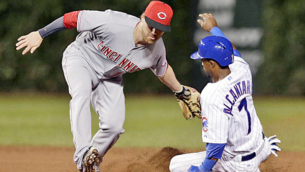 Cincinnati Reds' infielder Jake Elmore tags out Chicago Cubs' baserunner Arismendy Alcantara trying to steal second base in the fourth inning of Monday's game. The Cubs won 1-0 on a ninth inning home run by Anthony Rizzo. (Courtesy of the Cincinnati Reds.com)