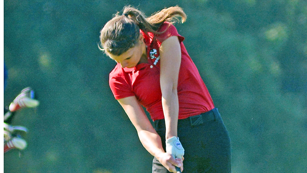Coal Grove Lady Hornets' Tori Holmes hits a tee shot. Holmes was second individually at the Division II sectional golf tournament and advances to the district next week. (Kent Sanborn of Southern Ohio Sports Photos)