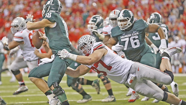Ohio State defensive end Joey Bosa (97) chases down Michigan State quarterback Connor Cook in last year's Big Ten championship game. Bosa is one of the key players when the Buckeyes host Virginia Tech on Saturday night in their home opener. (MCT Direct Photos)