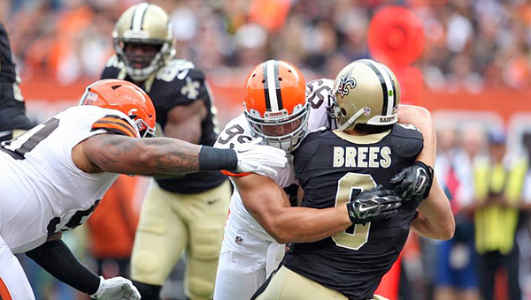Cleveland Browns' defensive lineman Paul Kruger (99) sacks New Orleans Saints' quarterback Drew Brees during Sunday's game in Cleveland. The Browns upset the Saints 26-24 on a last-second field goal by Billy Cundiff. (Courtesy of The Cleveland Browns.com)