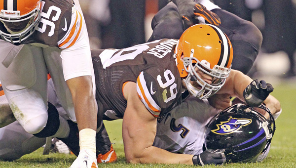 Cleveland Browns defensive lineman Paul Kruger (99) sacks Baltimore Ravens' quarterback Joe Flacco in a game last season. Kruger — a former Raven — and the Browns host Baltimore on Sunday. (MCT DIrect Photo)
