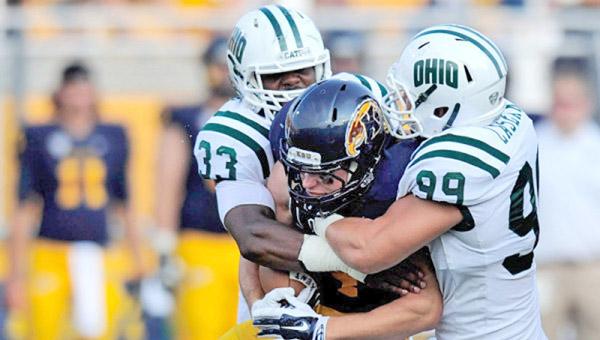 Ohio Bobcats' linebacker Blair Brown (33) and defensive end Kurt Laseak (99) make the stop on a Kent State running back. (Photo Courtesy of Daniel Kubus/Ohio Athletics)