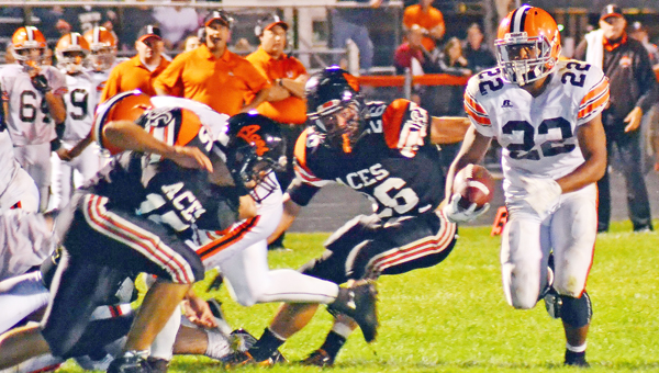 Ironton Fighting Tigers' running back D'Angelo Palladino (22) looks to outrun Amanda-Clearcreek defenders during last week's game. Palladino had 226 yards and four touchdowns in a 34-23 win. (Photo Courtesy of Circleville Herald)