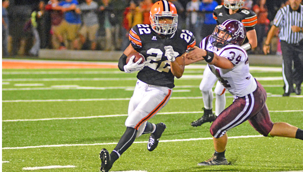 Ironton Fighting Tigers' junior running back D'Angelo Palladino (22) runs past Ashland's Cody Cline (34) as he gains some of his 270 yards in a 41-13 win on Friday. (Kent Sanborn of Southern Ohio Sports Photos)