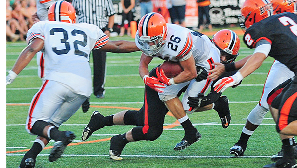 Ironton Fighting Tigers' running back Tanner Price (26) fights through a Wheelersburg defender during last week's game. Price ran for 45 yards on just five carries. Ironton plays at Russell on Friday. (Tony Shotsky of Southern Ohio Sports Photos)