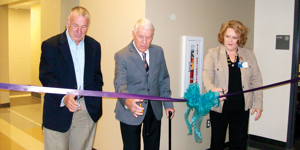 Superintendent Steve Dodgion along with school board president Carl Lilly and Jamie Chafin Director of Post Secondary Education at Collins Career Center cut the ribbon on the school's new health center.