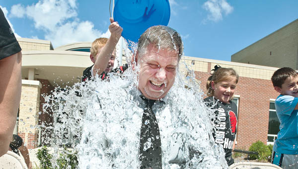 Superintendent Steve Easterling is drenched with a bucket of ice water, by his son, Stevie. Easterling and other faculty members at Dawson-Bryant Elementary take the popular Ice Bucket Challenge.