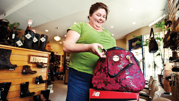 Jeanie Basham browses through a selection of purses while shopping at Unger's Shoes.