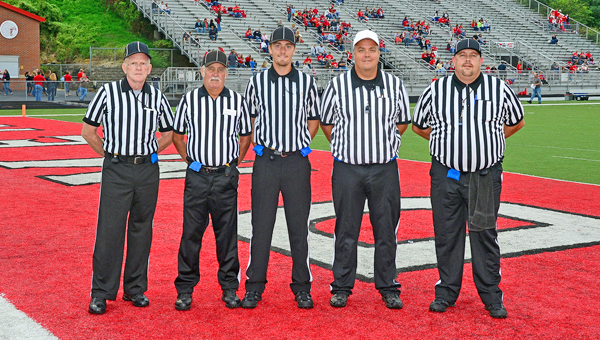 The five-man crew working last Friday's game that included the three generations of Mahlmeisters were, from left to right, Larry Chinn, Jim, Justin and Jimmy Mahlmeister, and Chuck Price.  (Kent Sanborn of Southern Ohio Sports)
