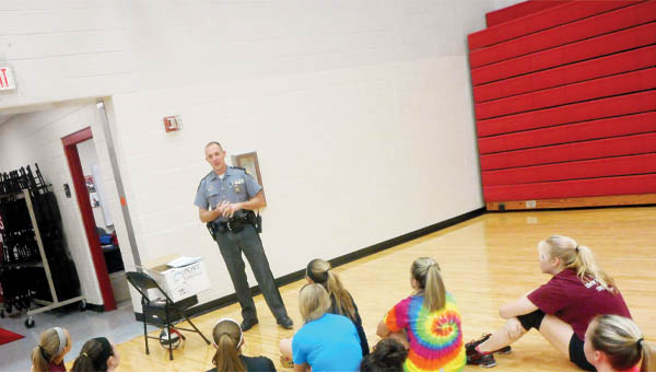 """The Tribune/Brandon Roberts Ohio State Highway Patrol Trooper Ryan Robirds speaks to the Coal Grove Hornets volleyball team about the statewide """"5 Minutes for Life"""" initiative, which includes talking for five minutes with student-athletes about responsible decision-making, leadership and encouraging their peers to live a drug-free lifestyle."""