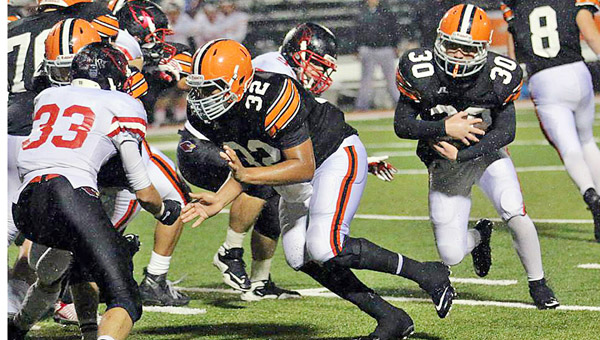 Ironton Fighting Tigers running back Andrew Barker (30) follows the lead block of fullback Desmond Young (32) during last Friday's 25-24 win over Division II Columbus St. Charles. Ironton hosts Meigs this Friday. (Photo Courtesy Tim Gearhart of Tim's News & Novelties of Ironton)