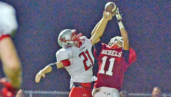 Symmes Valley Vikings' defensive back Levin Cade (21) knocks a pass away from a South Gallia receiver during an earlier game this season. (Robert S. Stevens & The Gold Studio of Ironton)