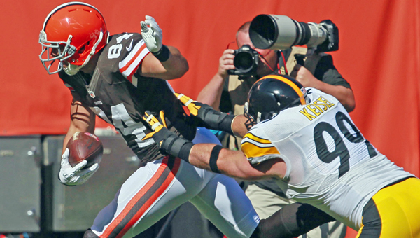 Cleveland Browns tight end Jordan Cameron is knocked out of bounds by Pittsburgh Steelers defensive end Brett Keisel after catching a pass from quarterback Brian Hoyer for a 42-yard gain during the first quarter on Sunday. (MCT Direct Photo)