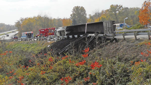 the Tribune/Brandon Roberts A semi truck hauling 25 tons of coal on Tuesday overturned on the State Route 243 off ramp headed eastbound toward U.S. 52.