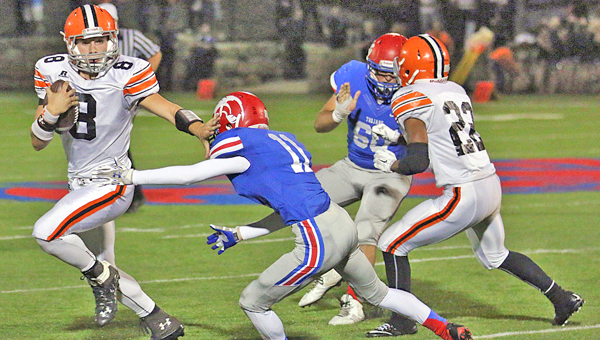 Ironton Fighting Tigers' quarterback Tristan Cox (8) sheds a tackler as he gains yardage in a recent win over Portsmouth. Ironton hosts Columbus St. Charles on Friday. (Photo Courtesy of Tim Gearhart of Tim's News & Novelties in Ironton)