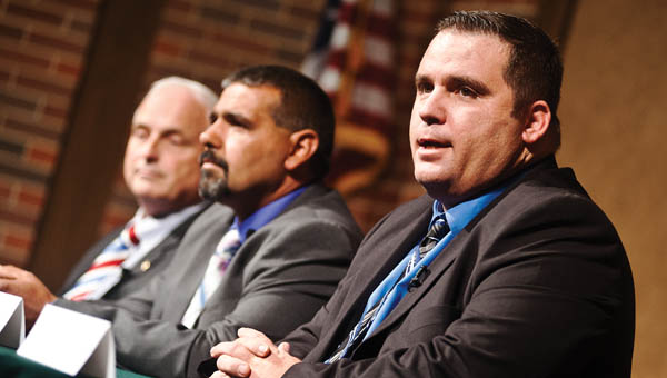 Josh Bailey, Thomas Jefferson Davis and Rep. Terry Johnson, pictured right to left, introduce themselves at the Candidate's Forum Tuesday at Ohio University Southern.