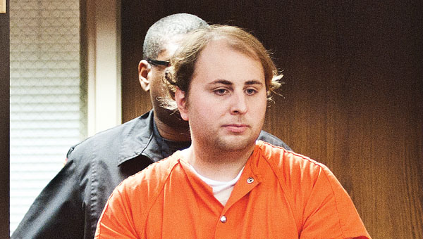 Kyle Parramore is escorted Wednesday into Lawrence County Common Pleas Court.