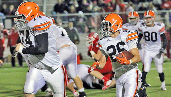 Ironton Fighting Tigers' guard Tyler Webb (74) leads running back Tanner Price (26) on a sweep during last Friday's game at unbeaten Jackson. Ironton will host the Raceland Rams at 7:30 p.m. Friday on Senior Night. (Photo Courtesy of Tim Gearhart of Tim's News & Novelties of Ironton)