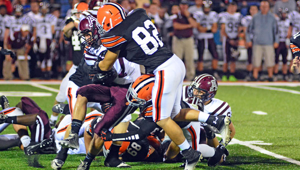 Ironton Fighting Tigers' defensive end Hunter Weber (82) makes a big defensive hit on Ashland quarterback Hunter Prince during a recent game. Ironton — who is open this week — is ranked third in Region 17 of Division V of the OHSAA computer playoff ratings. (Photo Courtesy of Tim Gearhart of Tim's News & Novelties In Ironton)