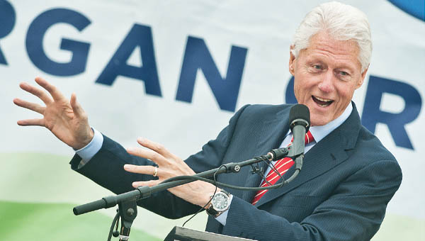 THE TRIBUNE/JESSICA ST JAMES Former President Bill Clinton speaks to Kentucky residents Thursday at the Ashland Train Station as he supports Alison Lundergan Grimes for U.S. Senate.
