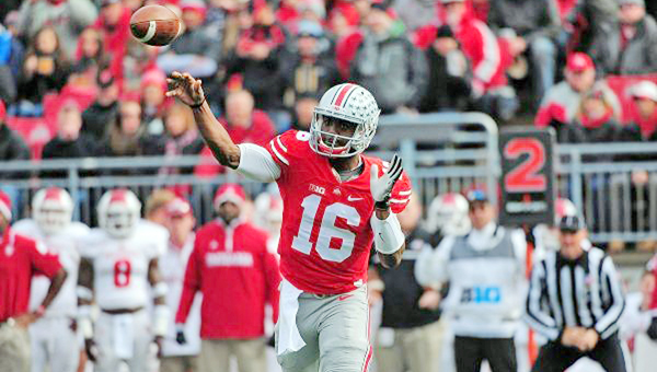 Ohio State Buckeyes' freshman quarterback J.T. Barrett will be the key in Saturday's Big Ten game against arch-rival  Michigan. Ohio State is a 20-point favorite. (MCT Direct Photos)