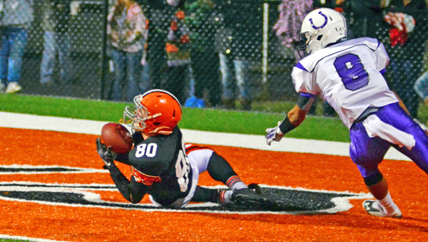 Ironton Fighting Tigers' Joe Bowling (80) makes a diving touchdown catch during the second quarter of Saturday's Division V Region 17 quarterfinal playoff game. Ironton won 26-13.  (Kent Sanborn of Southern Ohio Sports Photos)
