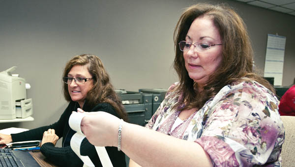 THE TRIBUNE/JESSICA ST JAMES Cathy Overbeck, right, and Cindy Ramsey, left, download election results Tuesday evening.