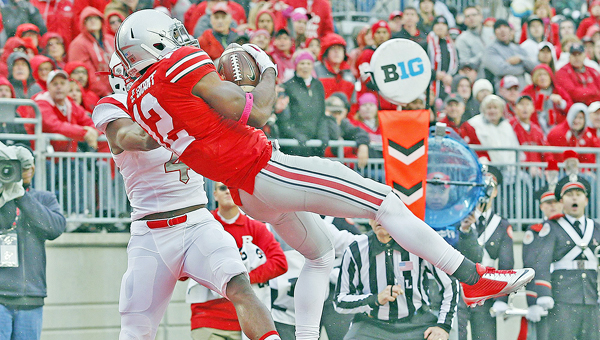Ohio State defensive back Doran Grant makes an interception. Grant says winning the Big Ten championship is more important than just beating Michigan. (MCT Direct Photo)