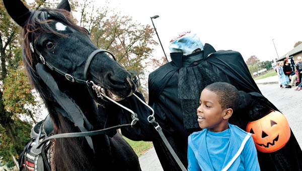 THE TRIBUNE/JESSICA ST JAMES Elijah Wood is more interested in the horse than The Headless Horseman during a special visit on Friday.