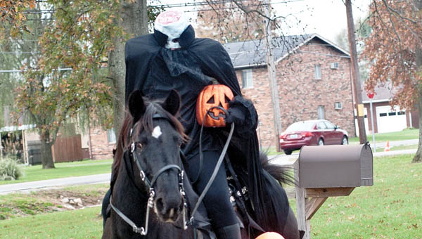Elijah Wood is more interested in the horse than The Headless Horseman during a special visit on Friday.