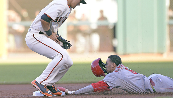 Cincinnati Reds' outfielder Billy Hamilton (right) steals second base during a game at San Francisco this past season. Hamilton was second in the voting for the National League Rookie of the Year behind New York Mets' pitcher Jacob deGrom. (MCT Direct Photos)