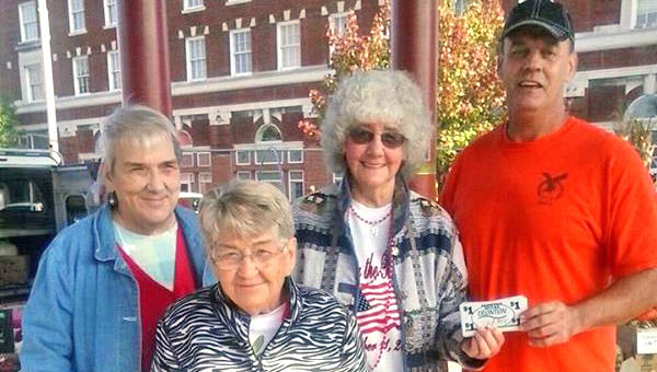 Larry Mader, far right, was the winner of 100 Ironton Bucks given away by the senior craft store. Pictured with Mader is and Judy Mills, Bonnie Fitzpatrick and Dot Collins of the senior craft store.