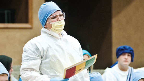 THE TRIBUNE/JESSICA ST JAMES Luke Malone, with Rock Hill Middle School, portrays an Ebola doctors from Guinea during the Model United Nations event Thursday at Ohio University Southern.