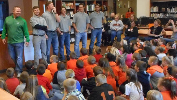 "Members of the Marshall Thundering Herd baseball team speak to a group of third-graders at Ironton Elementary as part of ""Operation Pay It Forward."""