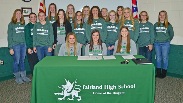 Fairland Lady Dragons' senior basketball guard Caitlin Stone signed a letter-of-intent to play at Urbana University. Stone was joined by her teammates to celebrate the signing ceremony. Stone, seated in the center, is surrounded by her teammates who include: Mackenzie Riley, Kelsey Riley, Jenna Fulks, Whitney Huff, Sarah Warnock, Taylor Staten, Donyele Edwards, Maddy Kazee, Issy McKinney, Nicole Wagner, Emily Chapman, Taylar Wilson, Morgan Fridley and Alesha Simpson. (Kent Sanborn of Southern Ohio Sports Photos)