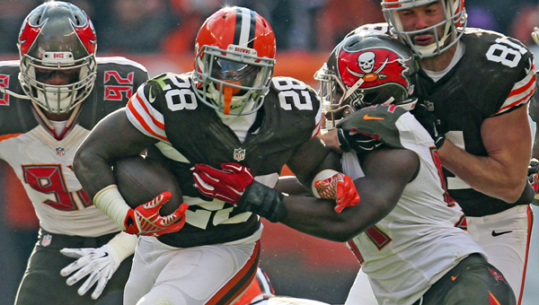 Cleveland running back Terrance West (28) tries to break away from a Tampa Bay defender during the second quarter on Sunday at FirstEnergy Stadium in Cleveland. The Browns won 22-17. (MCT Direct Photo)