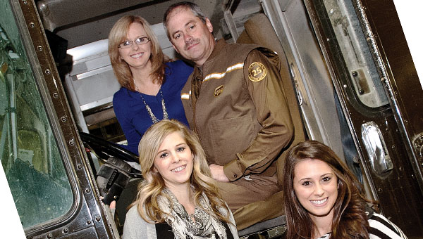 Ashland resident Dave Damron, with his wife, Silesia, and daughters, Allison Pettrey, left, and Lauren Damron, right, has said goodbye to UPS after 33 years of employment.