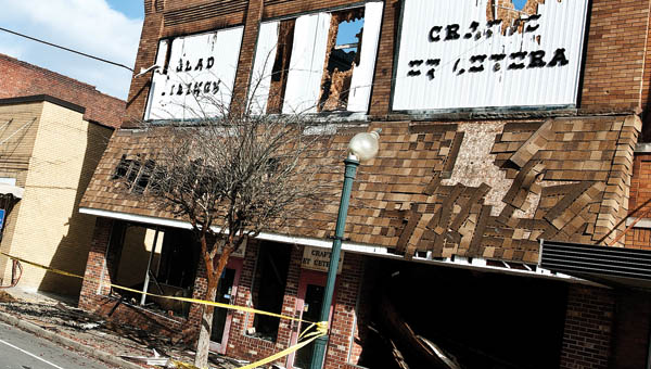 THE TRIBUNE/JESSICA ST JAMES South Third Street in downtown Ironton remains closed following Saturday evening's fire at the former Glad Tidings bookstore.