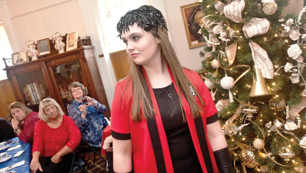 Grace Jenkins models an early 1970s outfit during the annual Christmas tea Saturday at the Lawrence County Museum.