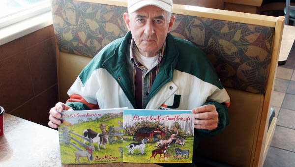 Proctorville resident Donnie McGraw shows off his two children's books that were just published this year.