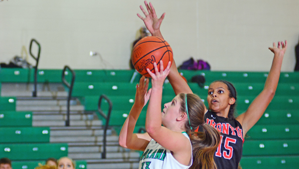 Ironton Lady Fighting Tigers' Lexie Barrier (15) goes for the blocked shot against Fairland Lady Dragons' Jenna Fulks (33). Barrier scored 28 points as Ironton won 51-46. (Kent Sanborn of Southern Ohio Sports Photos)