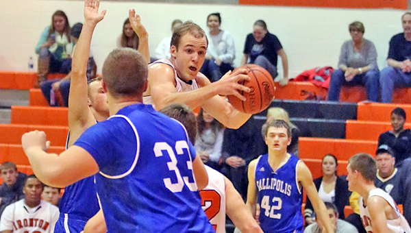 Ironton Fighting Tigers' Joe Bowling (10) grabs a rebound in a 54-40 win over the Gallipolis Blue Devils on Tuesday. (Photo Courtesy of Tim Gearhart of Tim's News & Novelties of Ironton)