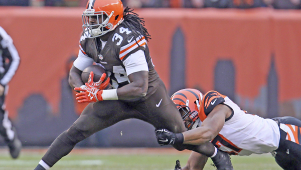 Cleveland's Isaiah Crowell is caught from behind by Cincinnati's Vincent Rey during the first quarter on Sunday FirstEnergy Stadium in Cleveland. (MCT Direct Photo)