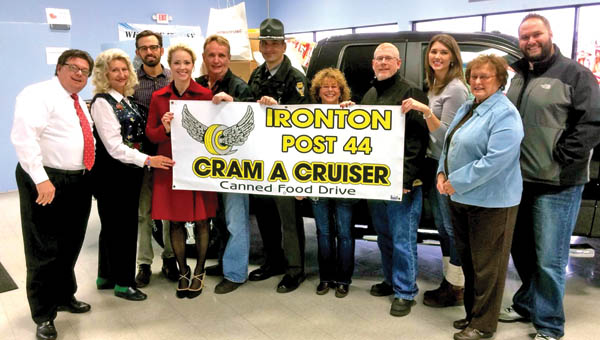 Submitted People from all of the organizations involved with the Cram the Cruiser Food Drive pose for a photo before food was taken to local food pantries.