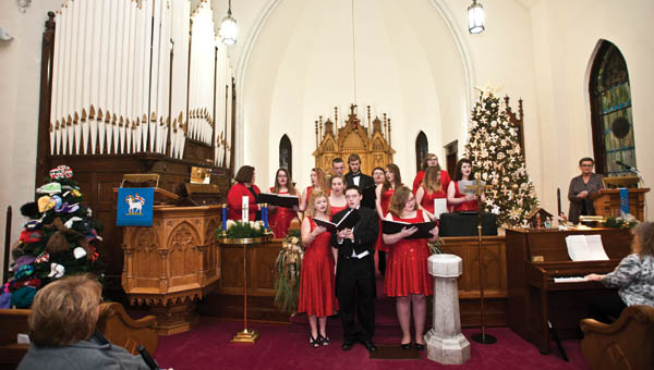 THE TRIBUNE/JESSICA ST JAMES Members of the Rock Hill High Show School Choir perform inside St. Paul Lutheran Church on Saturday during the Candlelight Christmas church walk in Ironton.