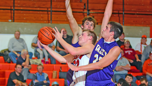 Ironton Fighting Tigers' Tristan Cox (22) goes in for two points between two Lucasville Valley defenders. Ironton's comeback fell short in a 47-44 loss on Tuesday. (Kent Sanborn of Southern Ohio Sports Photos)