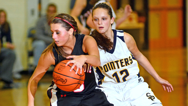 Coal Grove Lady Hornets' guard Jacy Jones (3) drives past South Point Lady Pointers Leah Lawson during Monday's OVC game. Coal Grove won 33-31. (Kent Sanborn of Southern Ohio Sports Photos.com)