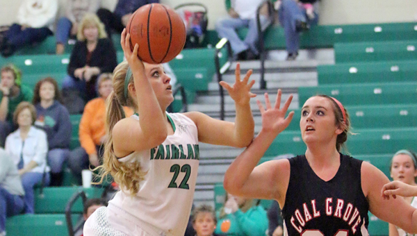 Fairland Lady Dragons' Kelsey Riley (22) hits a short jumper in the middle of the lane as Coal Grove Lady Hornets' Maddy McKenzie (24) runs to defend. Fairland won 62-45 on Monday in an Ohio Valley Conference game. (Kent Sanborn of Southern Ohio Sports Photos)